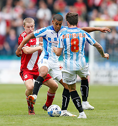 Lee Peltier of Huddersfield is challenged by Grant Leadbitter of Middlesbrough - Photo mandatory by-line: Rogan Thomson/JMP - 07966 386802 - 13/09/2014 - SPORT - FOOTBALL - Huddersfield, England - The John Smith's Stadium - Huddersfield town v Middlesbrough - Sky Bet Championship.