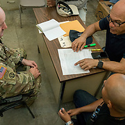 OCTOBER 20 - SANTA ISABEL, PUERTO RICO - <br /> Santa Isabel mayor Enrique Questell Alvarado, right,  and 105th Engineer Battalion Lt. Coronel Cale Moody, go over maps showing areas the town needs help from the US Military in. Municipal employee Ricky Burgos, middle, is translating.<br /> (Photo by Angel Valentin/Freelance)