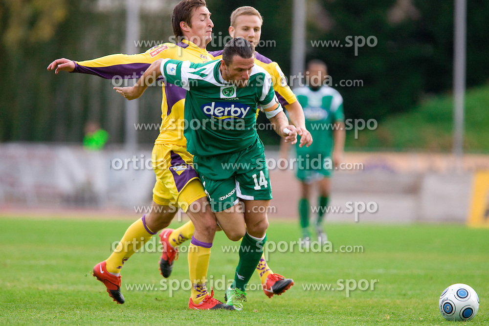 Armin Bacinovic of Maribor vs Sebastjan Cimirotic of Olimpija at 3rd Round of Hervis Slovenian Cup football match between NK Olimpija Ljubljana and NK Maribor,  on October 21, 2009, in Sportni park Ljubljana, Ljubljana, Slovenia.  Maribor won 1:0. (Photo by Vid Ponikvar / Sportida)
