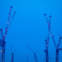 Where: Singapore, Cranes, Blue sky. I love the way the cranes seem to be reaching for the sky.