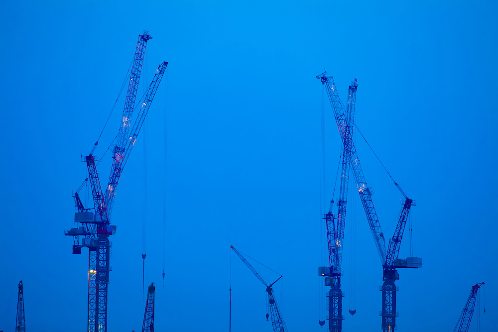 Where: Singapore, Cranes, Blue sky. I love the way the cranes seem to be reaching for the sky.