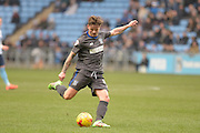 Bury Midfielder Andrew Tutte crosses during the Sky Bet League 1 match between Coventry City and Bury at the Ricoh Arena, Coventry, England on 13 February 2016. Photo by Dennis Goodwin.