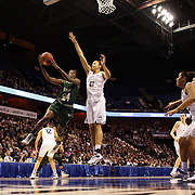 Alisia Jenkins, (left), drives past Kiah Stokes, UConn, during the UConn Huskies Vs USF Bulls Basketball Final game at the American Athletic Conference Women's College Basketball Championships 2015 at Mohegan Sun Arena, Uncasville, Connecticut, USA. 9th March 2015. Photo Tim Clayton
