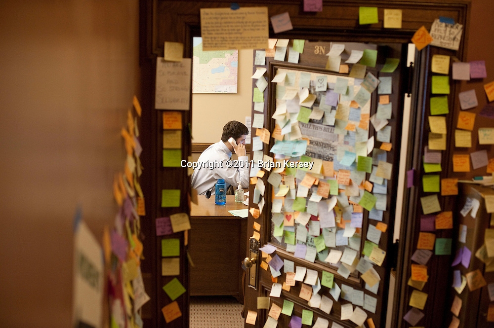 Notes of support adorn the office door of state Rep. Brett Hulsey as Ben Tobias talks on the phone at the state Capitol in Madison, Wisconsin on February 25, 2011. Protests over budget legislation continued at the state Capitol for the 11th day.      (Photo by Brian Kersey)
