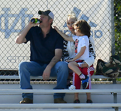 *PREMIUM EXCLUSIVE* Gwen Stefani and Blake Shelton ignore Gavin Rossdale at Kingston's Football game. Gwen and Blake were seen spending time cheering on Gwen's son Kingston at his football game along with their other kids, Apollo, and Zuma meanwhile completely ignoring the fact that Gavin was standing on the other side of the bleachers. Upon leaving they were also seen looking the other way as Gavin hugged his boys goodbye. During the game even Apollo and Zuma seemed to be happy to spend time with Blake. 16 Feb 2020 Pictured: Gwen Stefani, Blake Shelton and Gavin Rossdale. Photo credit: MEGA TheMegaAgency.com +1 888 505 6342