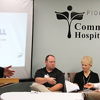 RAY VAN DUSEN/BUY AT PHOTOS.MONROECOUNTYJOURNAL.COM<br /> Gilmore Memorial Hospital Chief Executive Officer J. Allen Tyra, left, speaks about health care in Monroe County as part of a chamber of commerce chairman's committee on leadership luncheon at Pioneer Community Hospital, which also focused on education.
