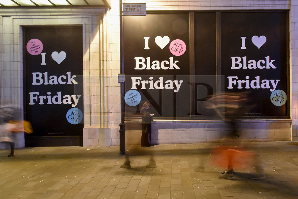 © Licensed to London News Pictures. 23/11/2018. LONDON, UK.  People pass outside the UGG store in Piccadilly Circus on Black Friday. Traditional retailers face increasing challenges to attract customers against their online competition.  Photo credit: Stephen Chung/LNP