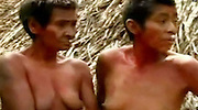 23/11/2010<br /> Seen for the first time: The Indian tribe lost in the heart of the Amazon jungle<br /> Bare to the waist and sporting rings in their upper lips, these are the extraordinary first pictures of a tribe lost in the heart of the Amazon rainforest.<br /> The natives are totally unknown to anthropologists, speak an unrecognisable language and do not even have a name for themselves.<br /> Astonishingly, their first contact with the outside world came by accident when staff at the Kugapakori Nahua Nanti nature reserve, in Peru, accidentally stumbled upon them.<br /> The nomads had been hunting for food and were tracked back to a temporary village constructed from cane and palm leaves.<br /> It was there that staff from the National Institute of Development of Andean, Amazonian and Afro-Peruvians (Indepa) studied them in secret for almost a year.<br /> They gradually began to interact with the tribe, who hunt with spears and knives, and build up a picture of their everyday lives.<br /> The discovery was eventually revealed earlier this week - along with footage of natives going about their daily lives.<br /> Mayta Capac Alatrista, the Indepa president explained how the tribe had been discovered as staff swept the area for illegal loggers.<br /> 'This contact was made because they went down to the streams in search of food,' he said.<br /> 'They are nomads. We have been able to casually initiate first contact.<br /> 'We've made a photographic record and have been able to bring them some tools that they have used to hunt, to fish and cook.'<br /> <br /> The Kugapakori Nahua Nanti park is in the south-east of Peru.<br /> Survival International, which campaigns for the rights of tribal people worldwide, estimates that there are 15 uncontacted Indian tribes in the country.<br /> These include the Cacataibo, Isconahua, Matsigenka, Mashco-Piro, Mastanahua, Murunahua (or Chitonahua), Nanti and Yora.<br /> But the organisation claims that all of them are under threat 
