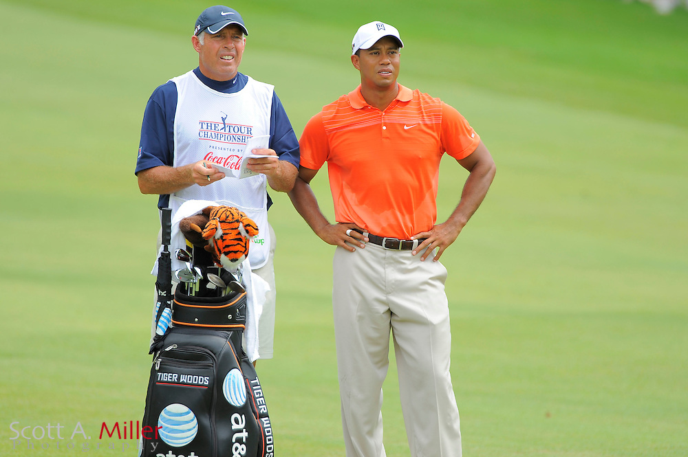 Tiger Woods (USA) and his caddie Steve Williams on the first hole during the second round of the PGA Tour Championship at East Lake Golf Club on Sept. 25, 2009 in Decatur, Ga.     ..©2009 Scott A. Miller