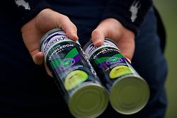 LONDON, ENGLAND - Monday, July 8, 2019: A ball boy holds tins of new balls during the Ladies' Singles fourth round match on Day Seven of The Championships Wimbledon 2019 at the All England Lawn Tennis and Croquet Club. (Pic by Kirsten Holst/Propaganda)