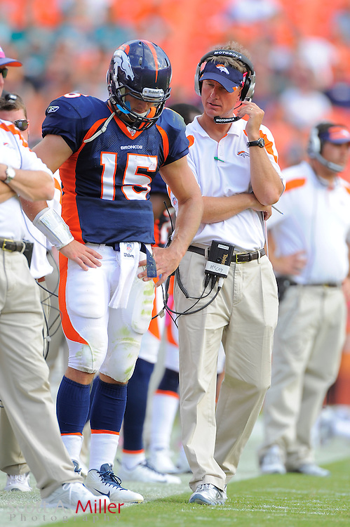 Denver Broncos quarterback Tim Tebow (15) and offensive coordinator Mike MCCoy during the Broncos 18-15 overtime win against the Miami Dolphins at Sun Life Stadium on Oct. 22, 2011 in Miami Gardens, Fla.  ...©2011 Scott A. Miller