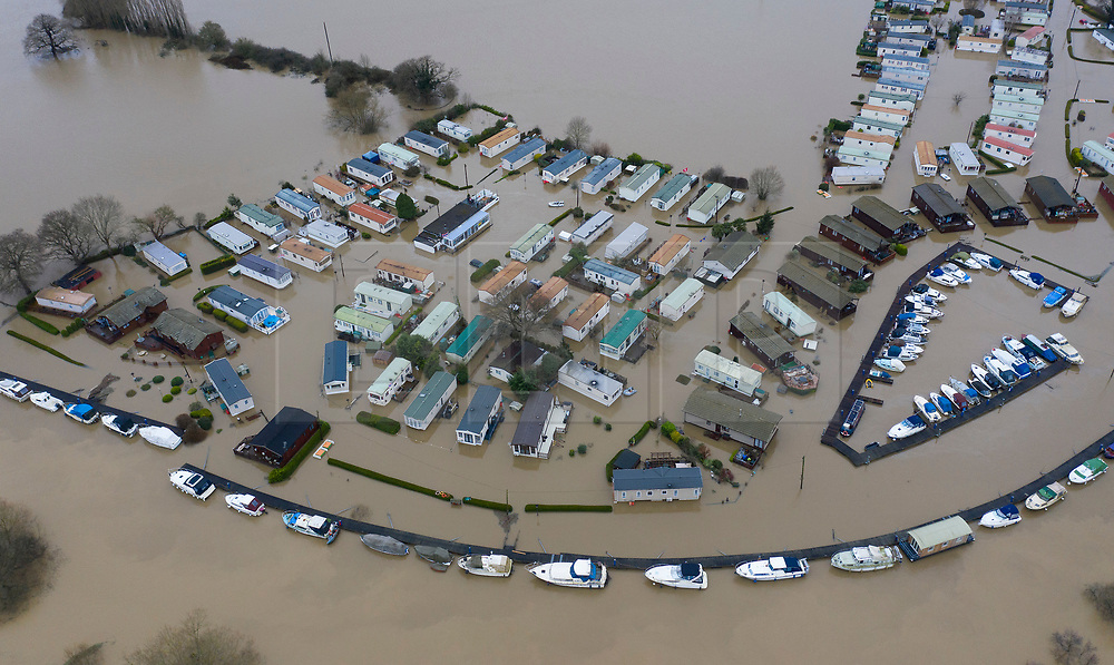DATE CORRECT AS CAPTIONED  © Licensed to London News Pictures. 22/12/2019. Yalding, UK. Boats are moored on the river Medway next as flood water has inundated the Little Venice caravan park near Yalding in Kent after the River Medway burst its banks. River levels remain high after a second night of heavy rain in the south. More rain is expected today. Photo credit: Peter Macdiarmid/LNP