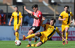 Exeter City's Jimmy Keohane is tackled by Southend United's Will Atkinson- Photo mandatory by-line: Harry Trump/JMP - Mobile: 07966 386802 - 18/04/15 - SPORT - FOOTBALL - Sky Bet League Two - Exeter City v Southend United - St James Park, Exeter, England.