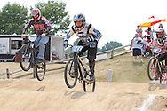 Sterling Werning (070), 19; Shawn McGovern (11), 36 of Troy and Nick Michael (2), 36 of Hamilton during the American Bicycle Association Kettering BMX single races at Delco Park in Kettering, July 1, 2012.