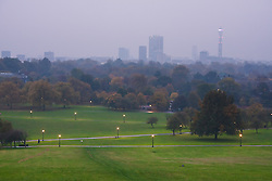 Primrose Hill, London, October 30th. As mist shrouds London's skline, fitness fanatics run and work out on Primrose Hill. Pictured: Mist hides much of London's skyline.