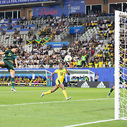 GRENOBLE, FRANCE June 18. Sam Kerr #20 of Australia scores her sect goal of the match heading past \goalkeeper Nicole McClure #13 of Jamaica during the Jamaica V Australia, Group C match at the FIFA Women's World Cup at Stade des Alpes on June 18th 2019 in Grenoble, France. (Photo by Tim Clayton/Corbis via Getty Images)