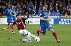Jack Marriott of Peterborough United skips past Shay Facey of Northampton Town - Mandatory by-line: Joe Dent/JMP - 02/04/2018 - FOOTBALL - ABAX Stadium - Peterborough, England - Peterborough United v Northampton Town - Sky Bet League One
