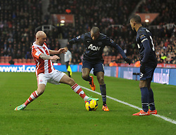 Stoke City's Erik Pieters tackles Manchester United's Ashley Young - Photo mandatory by-line: Alex James/JMP - Tel: Mobile: 07966 386802 01/02/2014 - SPORT - FOOTBALL - Britannia Stadium - Stoke-On-Trent - Stoke v Manchester United - Barclays Premier League