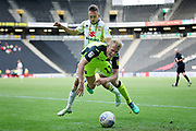 MKDons midfielder Lawson D'Ath (20) fouls Exeter City forward Jayden Stockley (11) during the EFL Sky Bet League 2 match between Milton Keynes Dons and Exeter City at stadium:mk, Milton Keynes, England on 25 August 2018.