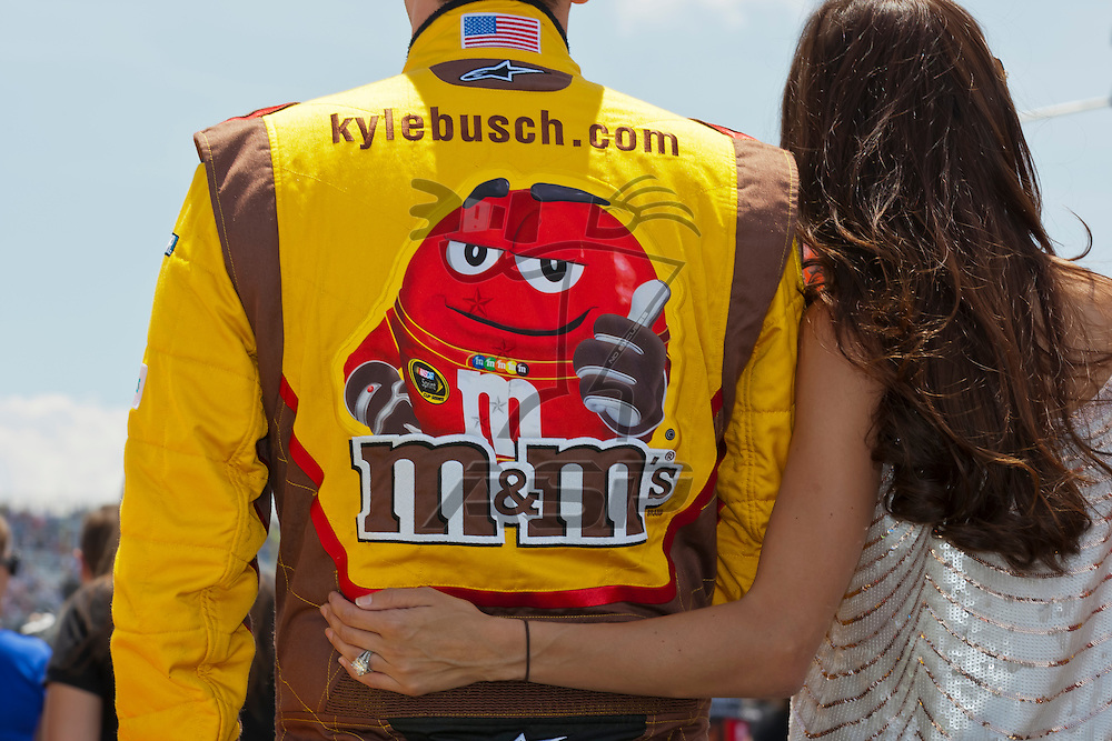 DOVER, DE - JUN 03, 2012:  Kyle Busch (18) and Samantha Busch stand for the National Anthem before the FedEx 400 Benefiting Autism Speaks at the Dover International Speedway in Dover, DE.
