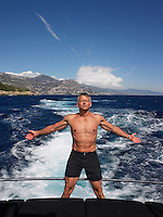 Man with Arms Outstretched on Boat