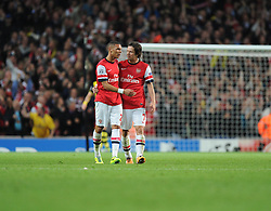Arsenal's Kieran Gibbs celebrates arsenals goal with Arsenal's Tomas Rosicky - Photo mandatory by-line: Alex James/JMP - Tel: Mobile: 07966 386802 22/10/2013 - SPORT - FOOTBALL - Emirates Stadium - London - Arsenal v Borussia Dortmund - CHAMPIONS LEAGUE - GROUP F