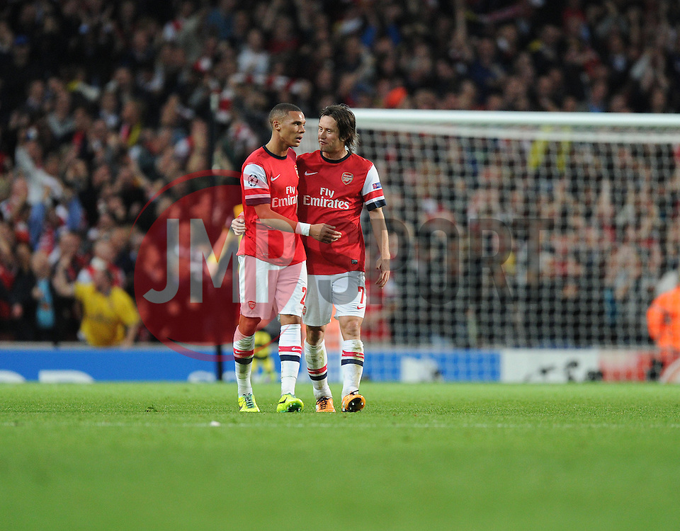 Arsenal's Kieran Gibbs celebrates arsenals goal with Arsenal's Tomas Rosicky - Photo mandatory by-line: Alex James/JMP - Tel: Mobile: 07966 386802 22/10/2013 - SPORT - FOOTBALL - Emirates Stadium - London - Arsenal v Borussia Dortmund - CHAMPIONS LEAGUE - GROUP F