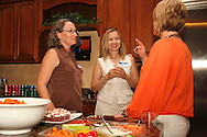 (from left) Bethany Schumacher of Konicki Schumacher Chiropractic, Julia Lamm of Tim Horton's and Nancy Earl-Stanley of Rodan + Fields Dermatologists during a Women in Business Networking After 5 event at Audio Etc. in Centerville, Thursday, August 30, 2012.