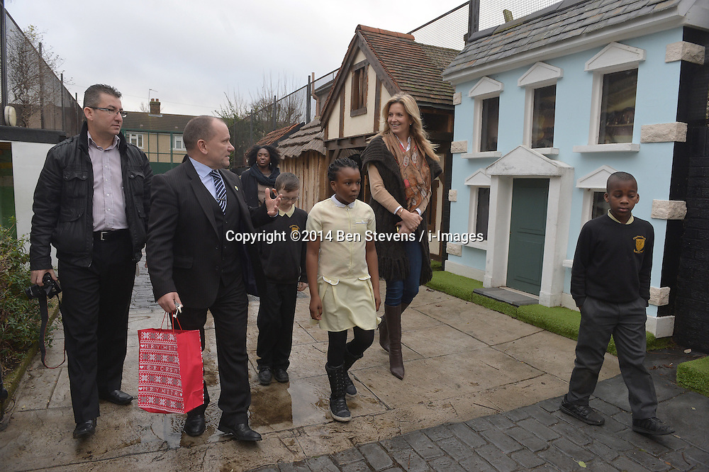 Image &copy;Licensed to i-Images Picture Agency. 18/12/2014. London, United Kingdom. <br /> <br /> Penny Lancaster visits Charlton Manor Primary School where the Mayors Fund initiative 'Penny for London' is raising money to fund breakfasts for school children.<br /> <br /> Picture by Ben Stevens / i-Images