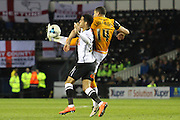 Hull midfielder Jake Livermore clears the ball from Derby midfielder Tom Ince during the Sky Bet Championship match between Derby County and Hull City at the iPro Stadium, Derby, England on 5 April 2016. Photo by Aaron  Lupton.