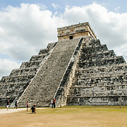 Wide shot of the steps of Temple of Kukulkan (El Castillo) at Chichen Itza Archeological Zone, ruins of a major Maya civilization city in the heart of Mexico's Yucatan Peninsula.