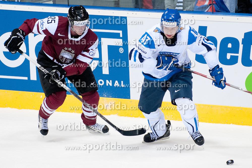 Janne Lahti of Finland vs Jekabs Redlihs of Latvia during ice-hockey match between Latvia and Finland of Group D of IIHF 2011 World Championship Slovakia, on May 2, 2011 in Orange Arena, Bratislava, Slovakia. (Photo by Matic Klansek Velej / Sportida)