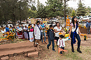 Family members hold a procession carrying offerings to the gravesite of a family member during the Day of the Dead festival October 31, 2017 in Tzintzuntzan, Michoacan, Mexico.
