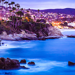 Panorama picture of Laguna Beach California city at night. Laguna Beach is a beach city along the Pacific Ocean in Southern California in the USA. Panoramic photo ratio is 1:3.