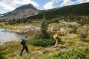 Alan Schmidt, Dave Costello and Parker Meek hiking in the Tweedsmuir National Park, BC, Canada