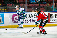 KELOWNA, BC - OCTOBER 16: Garrett Sambrook #27 of the Swift Current Broncos passes the puck during second period past Trevor Wong #8 of the Kelowna Rockets  at Prospera Place on October 16, 2019 in Kelowna, Canada. (Photo by Marissa Baecker/Shoot the Breeze)