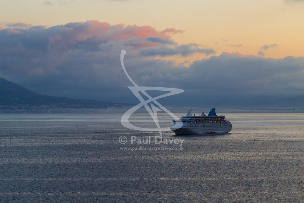 Sorrento, Italy, September 15 2017. A cruise liner arrives as day breaks in Sorrento, Italy. © Paul Davey