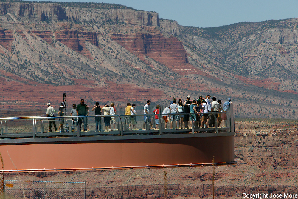 The Grand Canyon Skywalk is a transparent horseshoe-shaped cantilever bridge and tourist attraction in Arizona over looking the Colorado River on the edge of a side canyon in the Grand Canyon West area of the main canyon. Commissioned and owned by the Hualapai Indian tribe, opining in March 2007.  Photography by Jose More