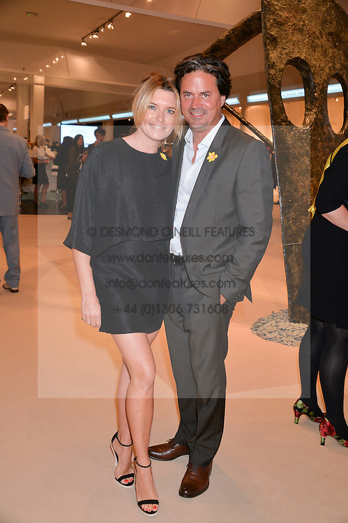TINA HOBLEY and OLIVER WHEELER at the Masterpiece Marie Curie Party supported by Jeager-LeCoultre held at the South Grounds of The Royal Hospital Chelsea, London on 30th June 2014.