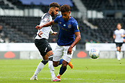 Jayden Bogle of Derby County makes a challenge on Ollie Watkins of Brentford  during the EFL Sky Bet Championship match between Derby County and Brentford at the Pride Park, Derby, England on 11 July 2020.