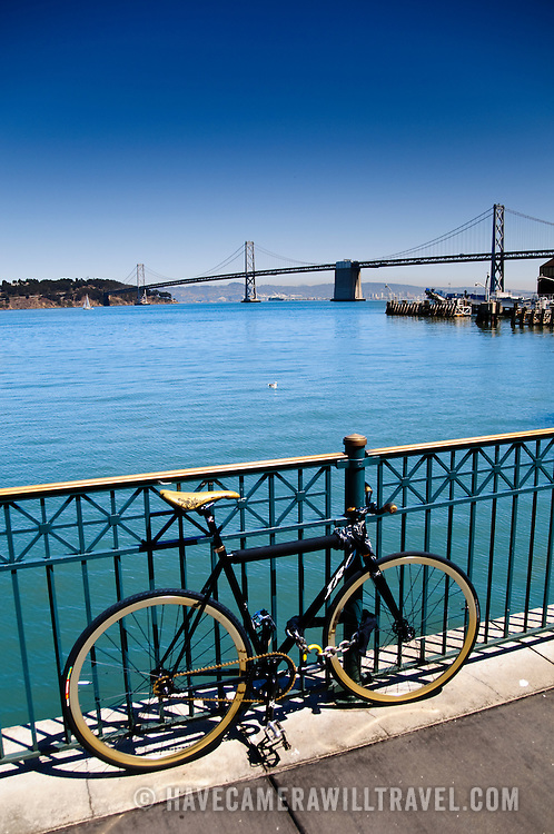 Waterfront at the Ferry Terminal near Pier One, with a bicycle in the foreground and the Bay Bridge in the background