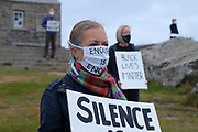 Climate change activists from Extinction Rebellion standing in solidarity with the world wide protest, Black Lives Matter following the death of George Floyd in the USA in their weekly protest called No Going Back which is usually linked to climate change and has now grown to become a national event, on Sunday at 10.00am on the 7th June 2020 in St Ives, United Kingdom. Black Lives Matter is an international human rights movement, originating from within the African-American community which campaigns against violence and systemic racism towards black people. Around 40 members of the St Ives community decided to protest by standing for an hour holding placards with slogans such as 'Black Lives Matter' and 'I can't breathe'. Here they are standing at the top of the town outside the famous chapel.