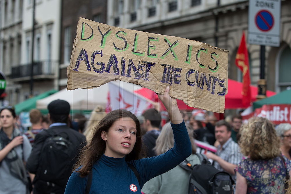 """© Licensed to London News Pictures . 20/06/2015 . London , UK . A woman with """" Dyslexics Against the Cunts """" banner in Parliament Square . Tens of thousands of people march from the Bank of England to Parliament , to protest economic austerity in Britain . Photo credit: Joel Goodman/LNP"""