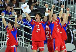 Team of Korea celebrates during 21st Men's World Handball Championship 2009 Main round Group I match between National teams of Slovakia and Korea, on January 24, 2009, in Arena Zagreb, Zagreb, Croatia.  (Photo by Vid Ponikvar / Sportida)