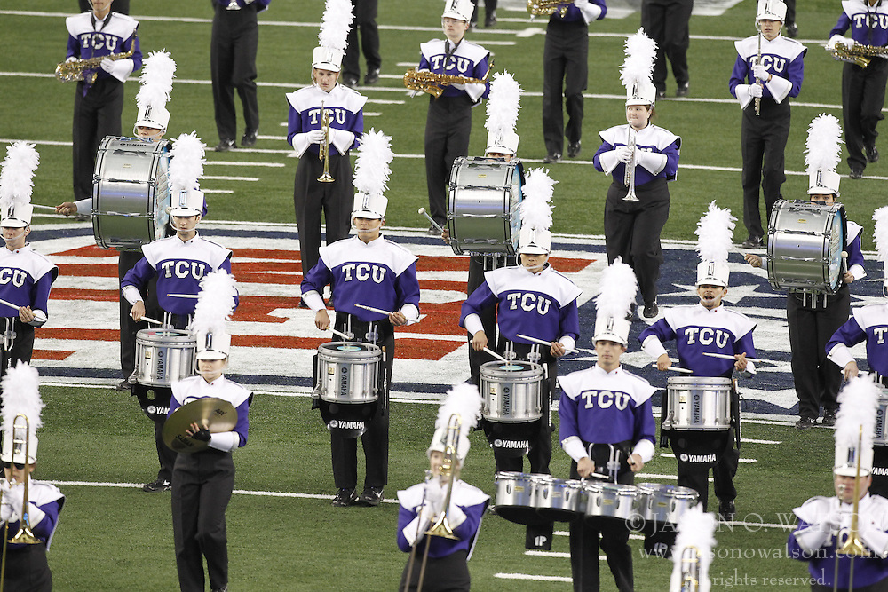 Feb 6, 2011; Arlington, TX, USA; Members of the TCU Horned Frogs marching band perform before Super Bowl XLV between the Green Bay Packers and the Pittsburgh Steelers at Cowboys Stadium.