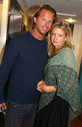 CHRISTOPHER GETTY and LAINEY SHERIDAN-YOUNG at the launch party for the fashion label Javovich-Hawk held at the Fifth Floor Cafe, Harvey Nichols, Knightsbridge, London on 27th April 2006.<br />
