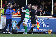 Jack Compton of Yeovil Town FC lifts Darren Way manager of Yeovil Town FC after scoring his penalty during the Sky Bet League 2 match between AFC Wimbledon and Yeovil Town at the Cherry Red Records Stadium, Kingston, England on 30 January 2016. Photo by Stuart Butcher.