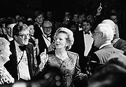 MARGARET THATCHER, Prime Minister, holds court at an after conference party for the Tory faithful in Brighton 1988.   Accompanied by husband Denis and her Chief Press Secretary Sir Bernard Ingham. <br />   Photograph &copy; Howard Barlow