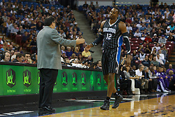 Jan 8, 2012; Sacramento, CA, USA; Orlando Magic center Dwight Howard (12) reacts in front of head coach Stan Van Gundy (left) after receiving his second personal foul against the Sacramento Kings during the first quarter at Power Balance Pavilion. Mandatory Credit: Jason O. Watson-US PRESSWIRE