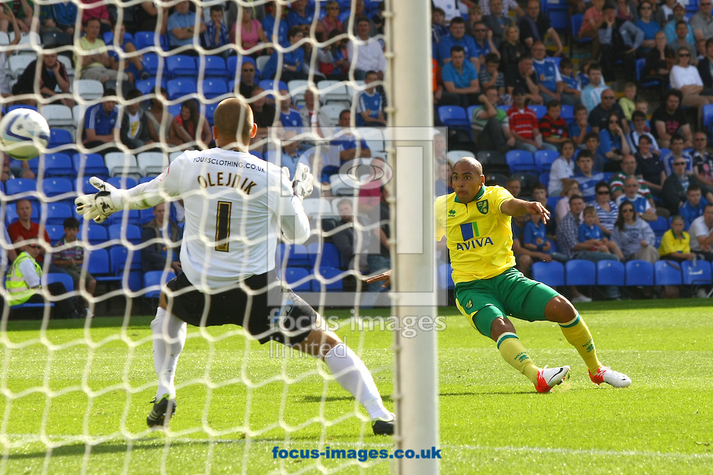 Picture by Paul Chesterton/Focus Images Ltd +44 7904 640267.28/07/2012.Grant Holt of Norwich puts James Vaughan of Norwich through who beats the last defender Gabriel Zakuani of Peterborough to score his sides 2nd goal and celebrates during the Friendly match at London Road, Peterborough.